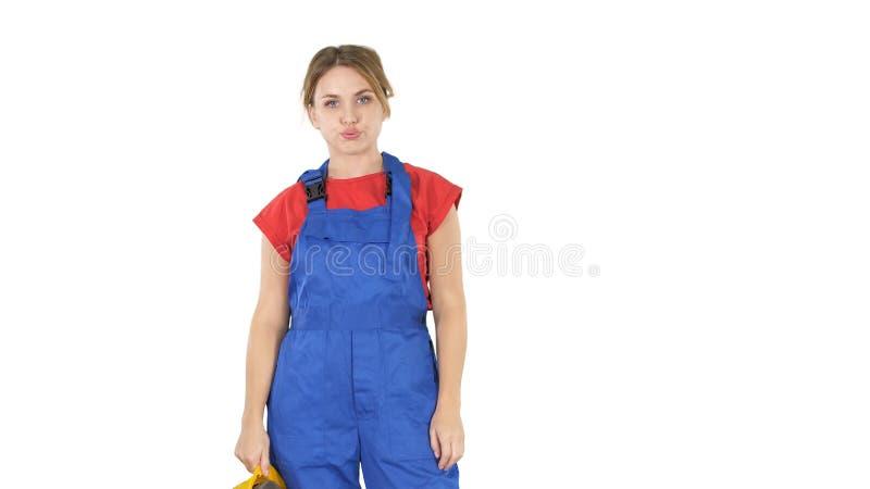 Kvinnaarbetaren tröttade mycket på vit bakgrund arkivfoto