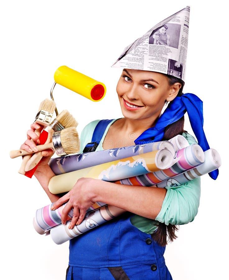 Kvinnabyggmästare med konstruktionshjälpmedel. royaltyfri foto