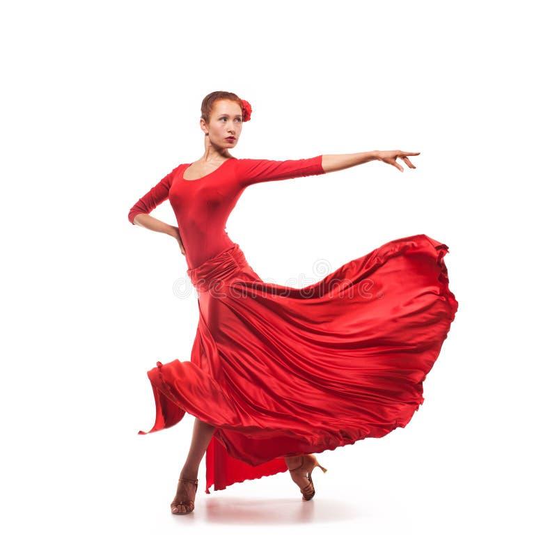 Kvinnadansare Som Bär Den Röda Klänningen Fotografering för