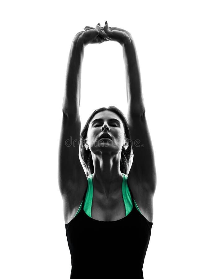 Kvinnadansare som sträcker värma övningskonturn upp royaltyfria foton