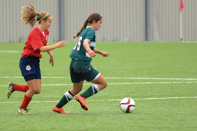 Kvinnafotbolllek royaltyfria foton