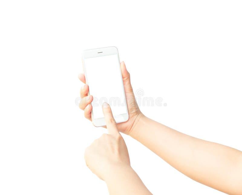 Kvinnahand som rymmer den vita smartphonen arkivbilder
