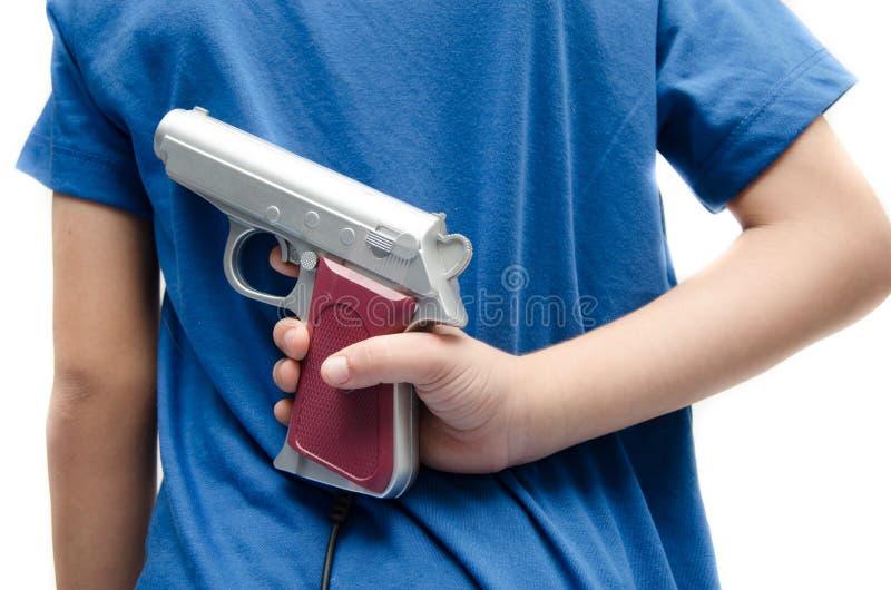 Kvinnahand som tar vapnet som väntar för att skjuta sig arkivbilder