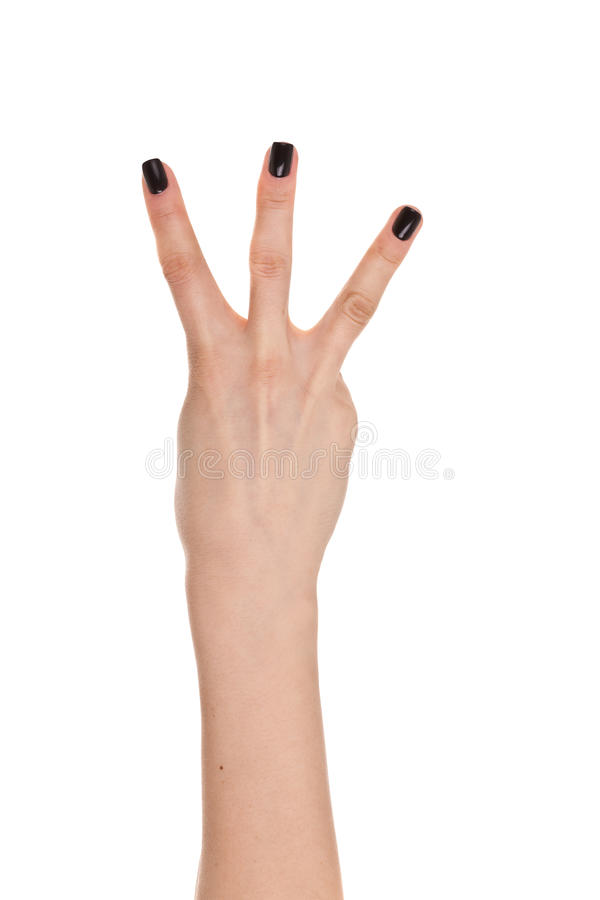 Kvinnahand som visar de tre fingrarna som isoleras på en vit backgr arkivbilder