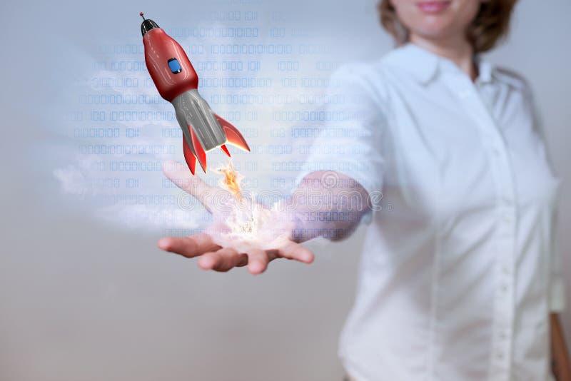 KvinnahandDigital röd raket arkivfoton
