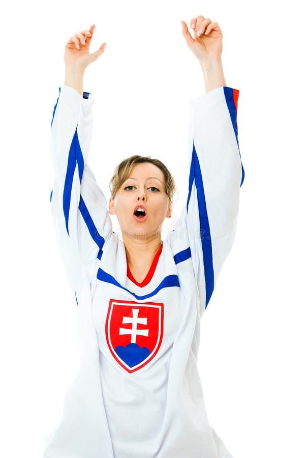 Kvinnahockeyfan i ärmlös tröja i nationell färg av Slovakien jubel som firar mål royaltyfria foton