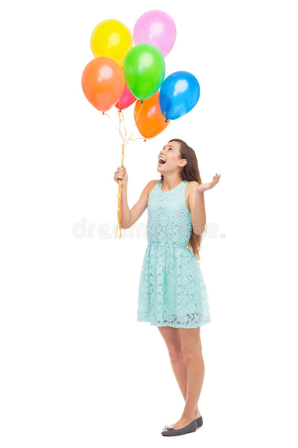 Kvinnaholdingballonger Royaltyfri Bild