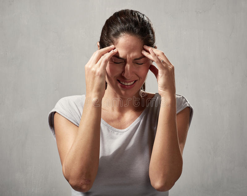 Kvinnahuvudvärk royaltyfri foto