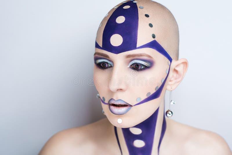 Kvinnakonstsmink arkivfoto