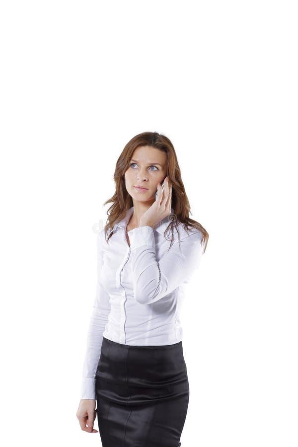Kvinnakonsulent som talar på en mobiltelefon arkivbilder