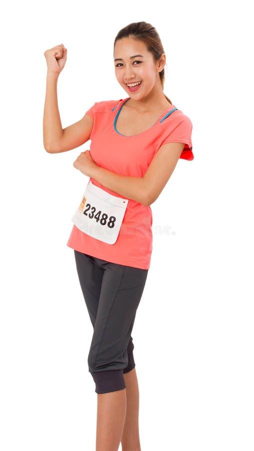 Kvinnalöpare som isoleras på vit arkivfoton