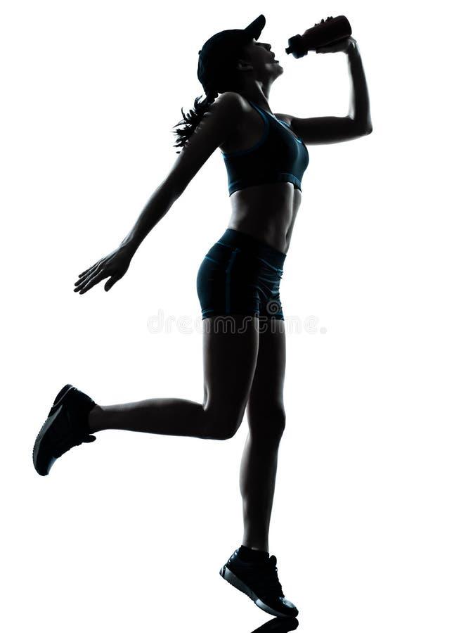 Kvinnalöparejogger som dricker konturn arkivfoto