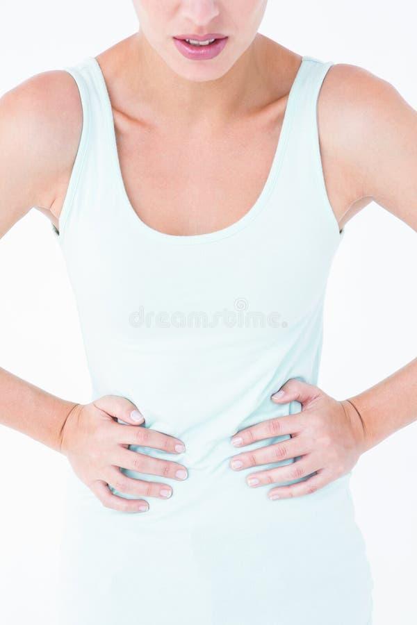 Kvinnalidande från magen smärtar royaltyfria bilder