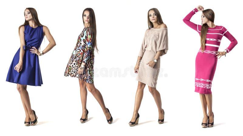 Kvinnamodell i oavkortad längd för kort klänning i studio på vitbac arkivfoton