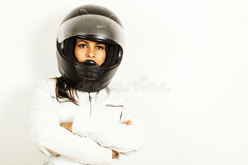 Kvinnamotorcyklist royaltyfria foton