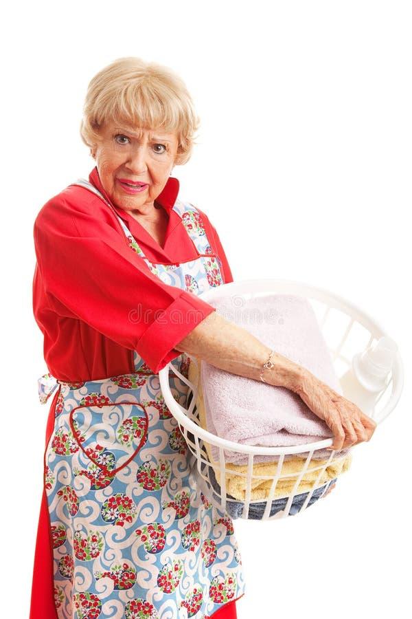 Kvinnan hatar tvätterit fotografering för bildbyråer