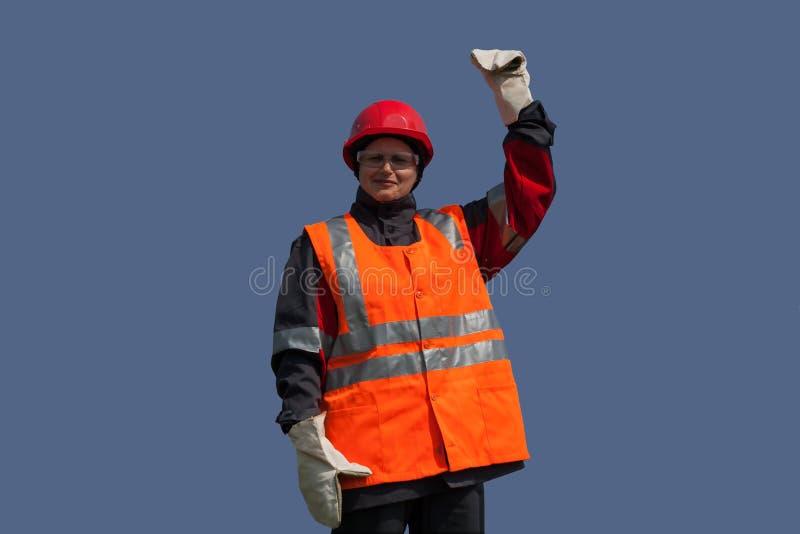 Kvinnan i skyddande funktionsduglig kläder arbets- skydd royaltyfria bilder