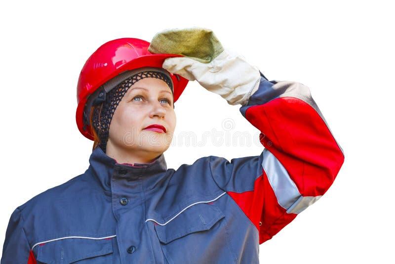Kvinnan i skyddande funktionsduglig kläder arbets- skydd Under konstruktion royaltyfria bilder