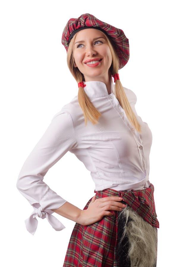 Kvinnan i traditionella skotska kläder royaltyfri bild