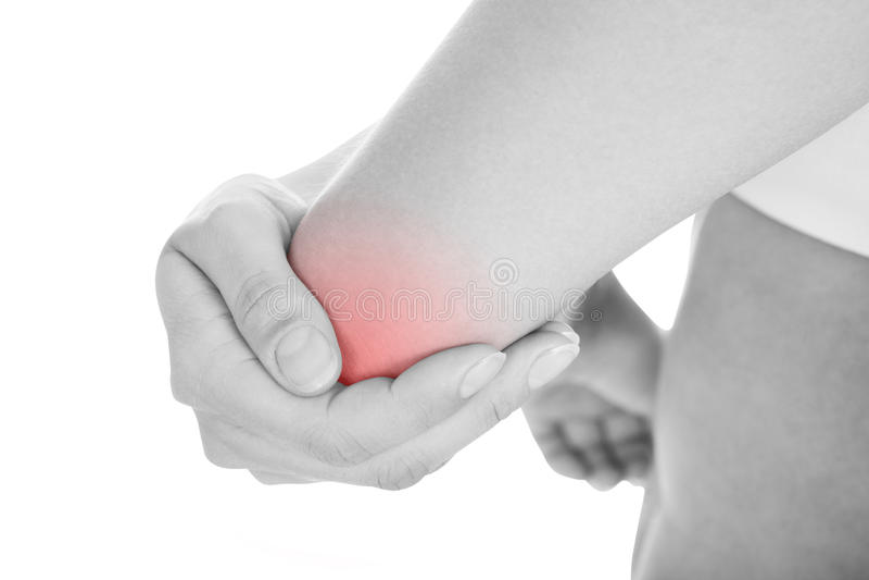 Kvinnan med armbågen smärtar arkivbild