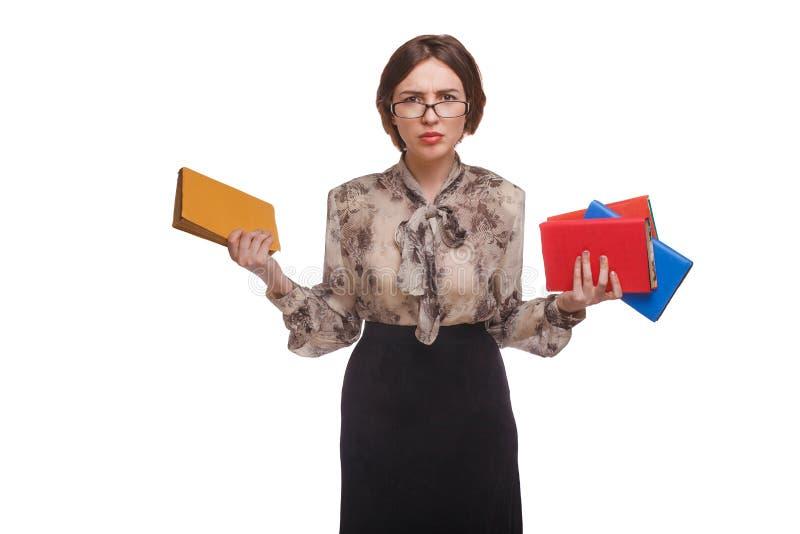 Kvinnan med böcker i exponeringsglaslärare isolerade vit arkivbild