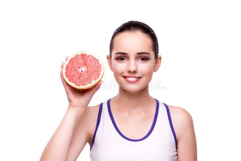 Kvinnan med grapefrukten som isoleras på vit arkivfoto