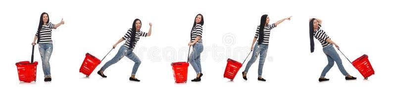 Kvinnan med shoppingvagnen som isoleras p? vit arkivfoton
