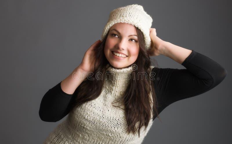 Kvinnan och värme kläder arkivfoton
