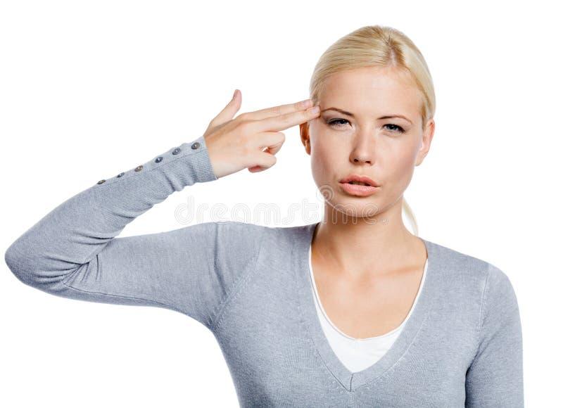 Kvinnan räcker att göra en gest för vapen arkivfoton