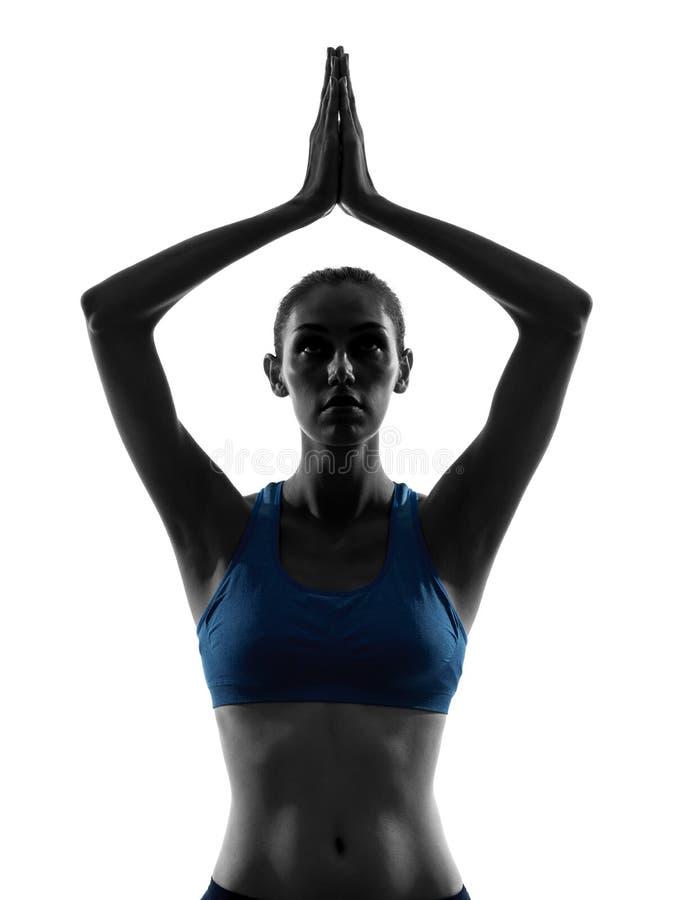 Kvinnan som övar yogahänder, sammanfogade ståenden royaltyfri bild