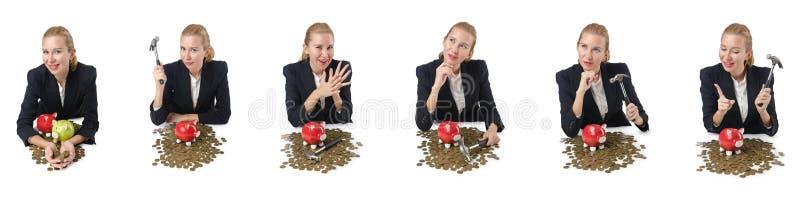 Kvinnan som bryter spargrisen för besparingar royaltyfria foton