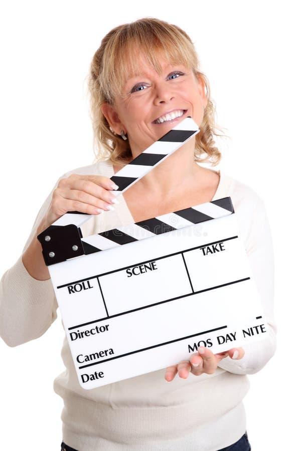 Kvinnan som rymmer en film, kritiserar arkivfoto