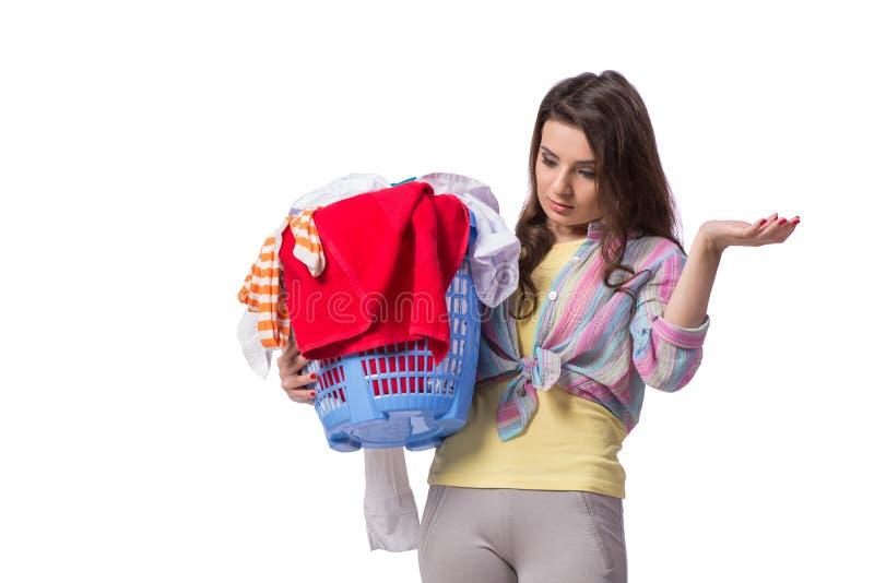 Kvinnan tröttade, når han har gjort tvätterit som isolerades på vit arkivfoto