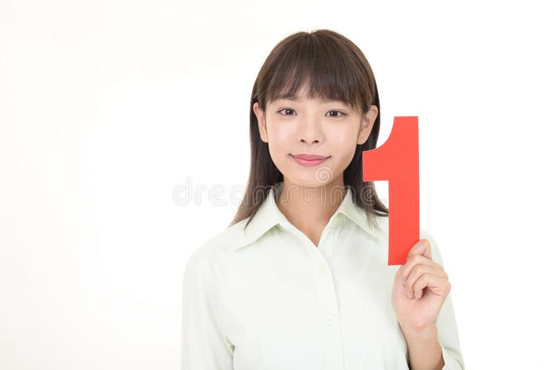 Kvinnaorganisationsnummer ett arkivfoton