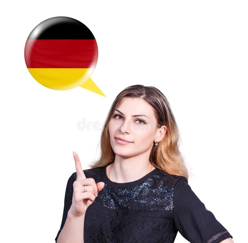 Kvinnapunkt på bubblan med den tyska flaggan royaltyfri foto