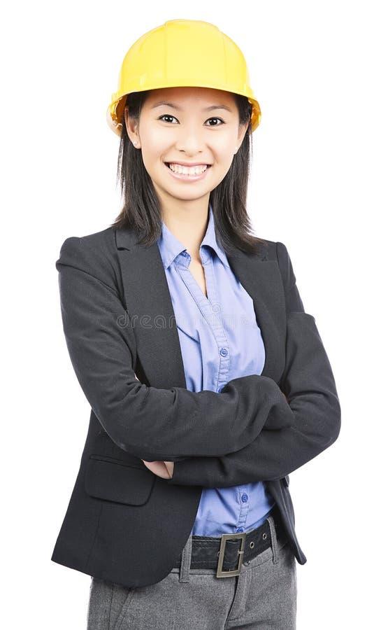 Kvinnastående för hård hatt royaltyfria foton