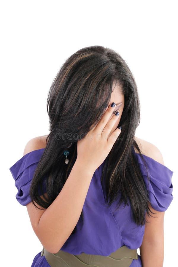 Kvinnauppvisningsspänning arkivfoto