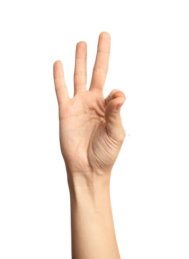 Kvinnavisning nummer nio på vit bakgrund Teckenspråk arkivbilder