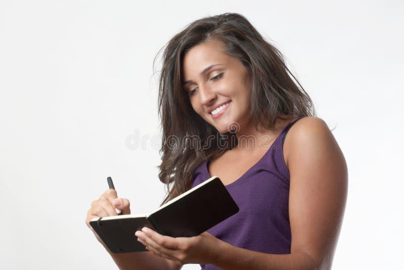 kvinnawriting royaltyfri fotografi