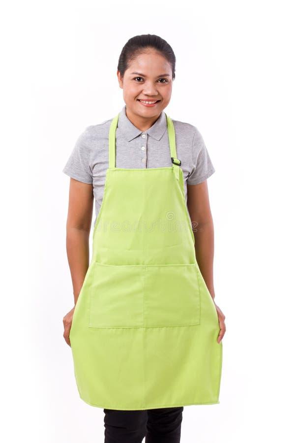 Kvinnlig anställd, arbetare med förklädet arkivbild