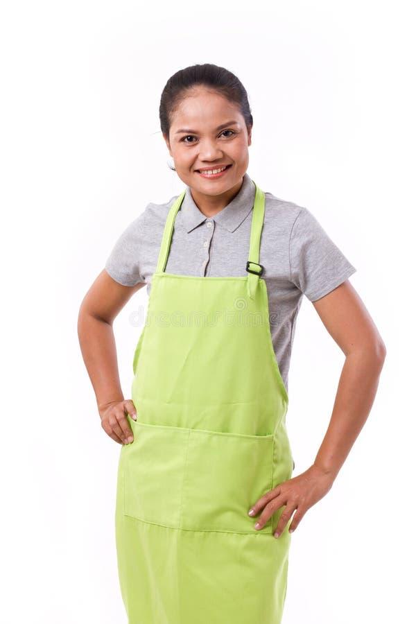 Kvinnlig anställd, arbetare med förklädet royaltyfri foto