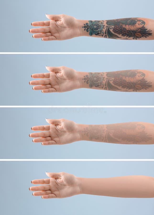 Kvinnlig arm med tatueringen arkivbild