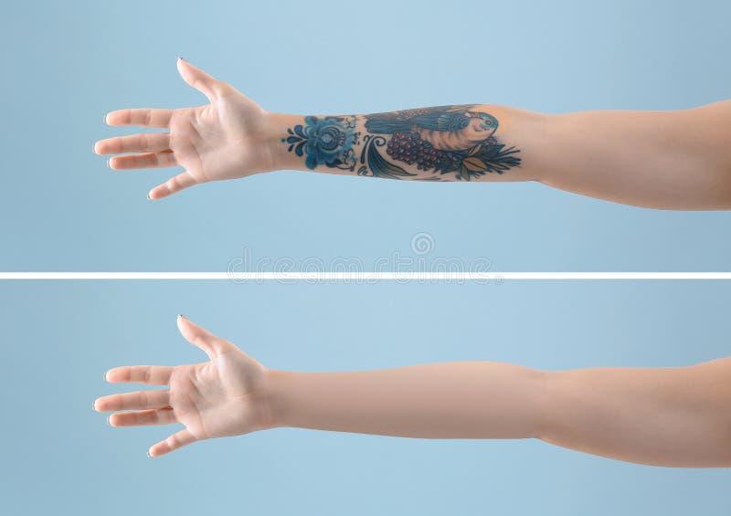 Kvinnlig arm med tatueringen arkivbilder