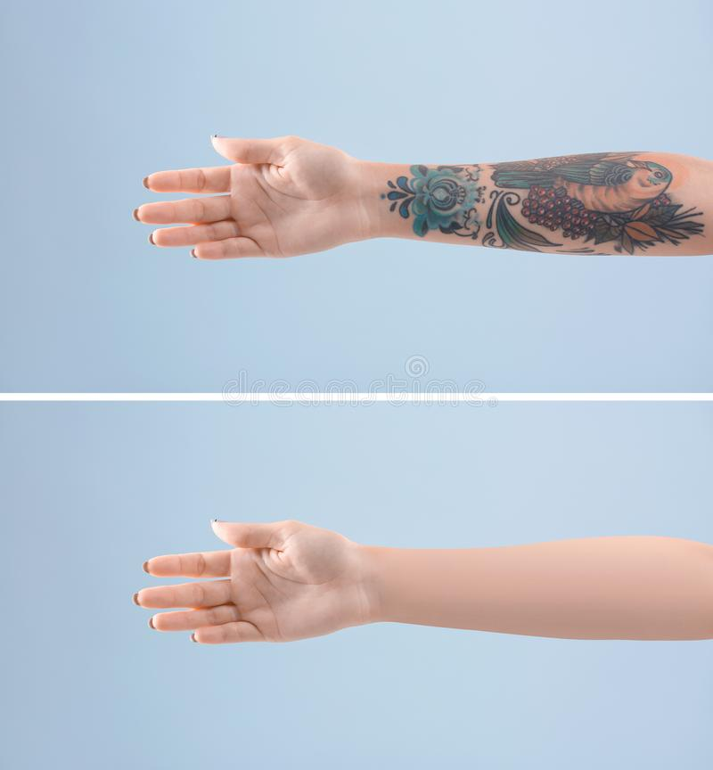 Kvinnlig arm med tatueringen royaltyfria bilder