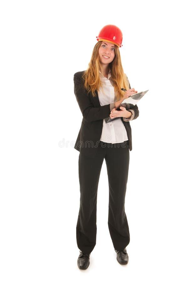 Kvinnlig byggmästare med hjälmen royaltyfri bild