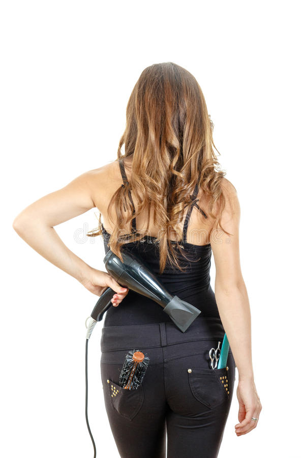 Kvinnlig frisör som bakifrån poserar att rymma hårtork med bru royaltyfria bilder