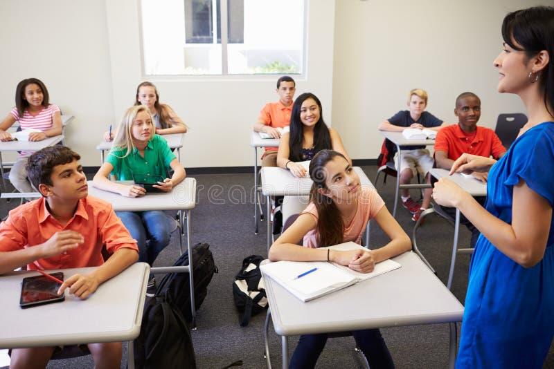 Kvinnlig högstadiumlärare Taking Class royaltyfria bilder