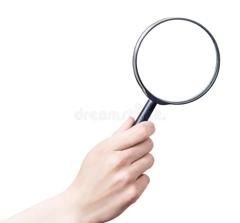 Kvinnlig hand med förstoringsglaset arkivbild