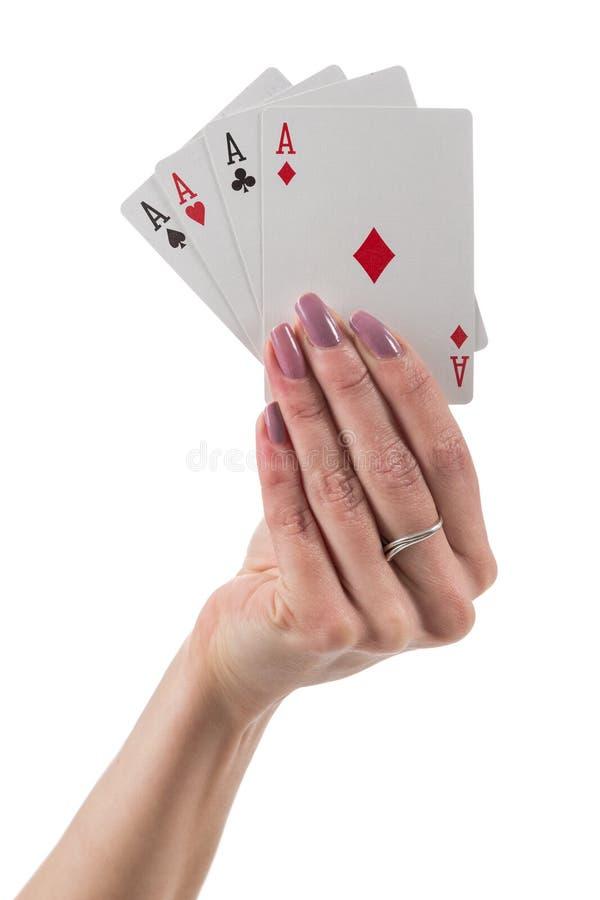Kvinnlig hand som visar fyra överdängare kort arkivbild