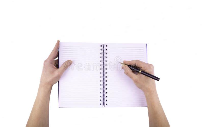 Kvinnlig handinnehavpenna som skriver bästa sikt royaltyfri fotografi